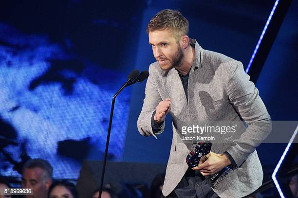 Recording artist Calvin Harris accepts the award for 'Dance Artist of the Year' onstage at the iHeartRadio Music Awards which broadcasted live on TBS...