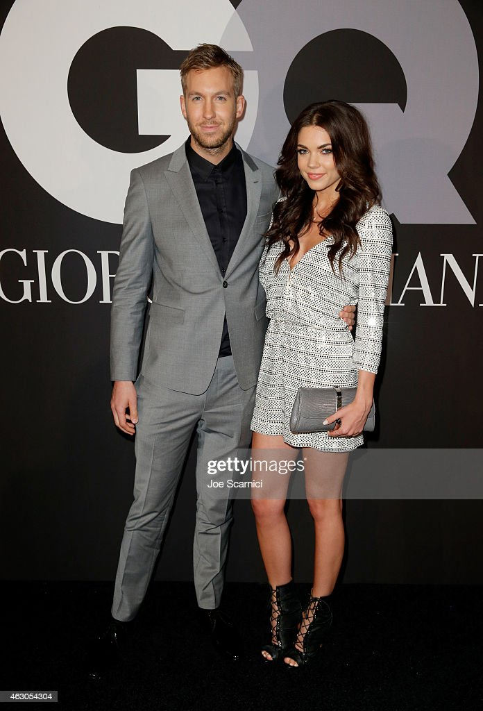 Recording artist Calvin Harris (L) and model Aarika Wolf attend GQ and Giorgio Armani Grammys After Party at Hollywood Athletic Club on February 8, 2015 in Hollywood, California.