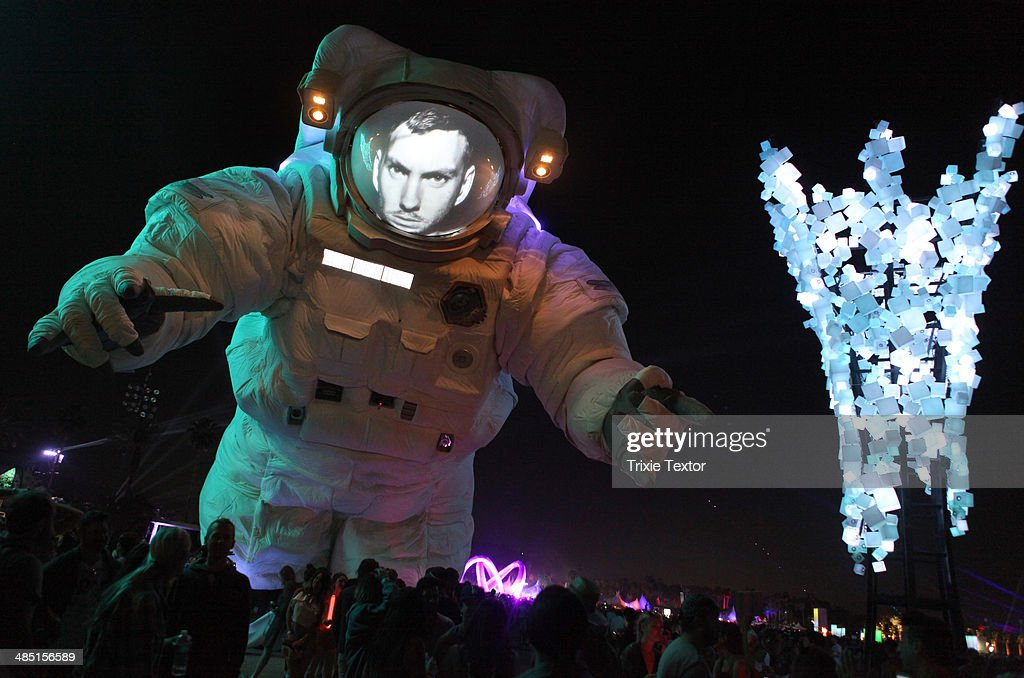 Recording Artist Calvin Harris face is projected on the Coachella Moon Man (Escape Velocity art installation by Poetic Kinetics) during day 3 of the 2014 Coachella Valley Music & Arts Festival at the Empire Polo Club on April 13, 2014 in Indio, California.