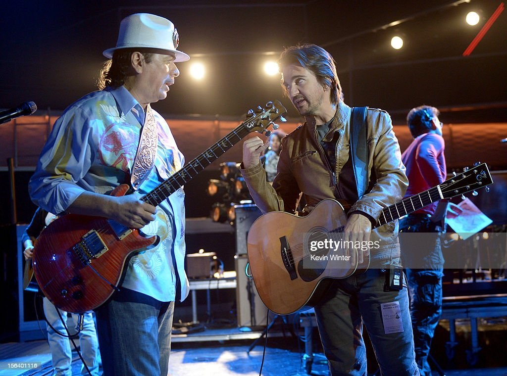 Recording artist Carlos Santana (L) and singer/songwriter Juanes talk onstage during rehearsals for the 13th annual Latin GRAMMY Awards at the Mandalay Bay Events Center on November 14, 2012 in Las Vegas, Nevada.