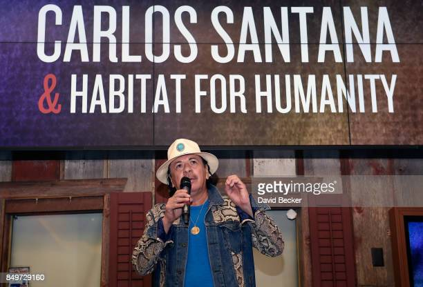Recording artist Carlos Santana attends the unveiling of the first of five specially designed park benches and the announcement of a community...