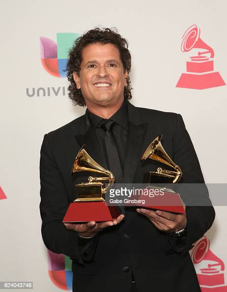 Recording artist Carlos Vives poses with the Song Of The Year and Record Of The Year awards in the press room during The 17th Annual Latin Grammy...