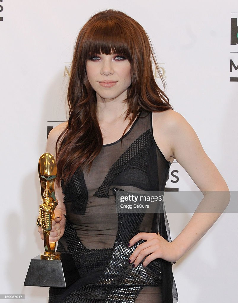 Recording artist <a gi-track='captionPersonalityLinkClicked' href=/galleries/search?phrase=Carly+Rae+Jepsen&family=editorial&specificpeople=6903584 ng-click='$event.stopPropagation()'>Carly Rae Jepsen</a> poses in the press room at the 2013 Billboard Music Awards at MGM Grand Garden Arena on May 19, 2013 in Las Vegas, Nevada.