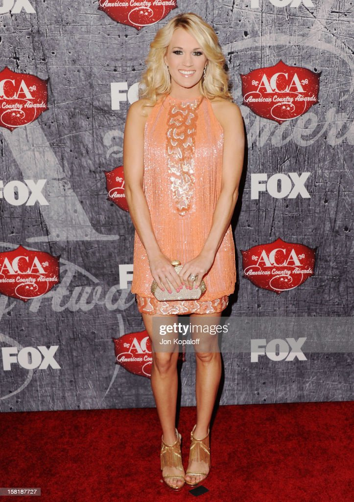 Recording artist <a gi-track='captionPersonalityLinkClicked' href=/galleries/search?phrase=Carrie+Underwood&family=editorial&specificpeople=204483 ng-click='$event.stopPropagation()'>Carrie Underwood</a> arrives at the 2012 American Country Awards at Mandalay Bay on December 10, 2012 in Las Vegas, Nevada.