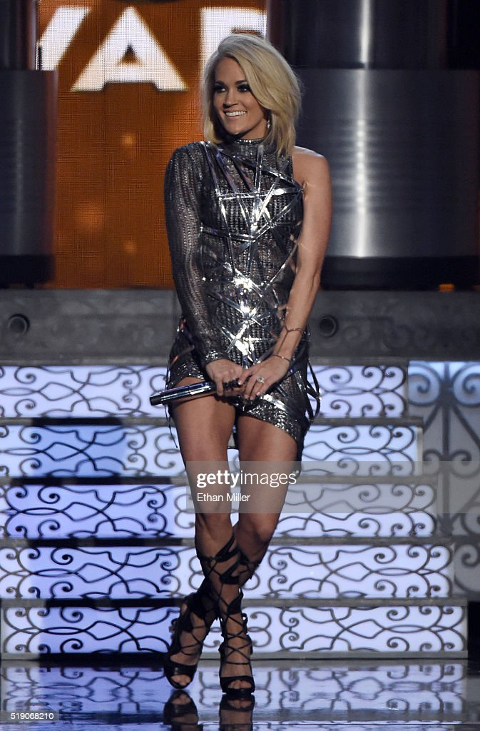 Recording artist <a gi-track='captionPersonalityLinkClicked' href=/galleries/search?phrase=Carrie+Underwood&family=editorial&specificpeople=204483 ng-click='$event.stopPropagation()'>Carrie Underwood</a> performs during the 51st Academy of Country Music Awards at MGM Grand Garden Arena on April 3, 2016 in Las Vegas, Nevada.