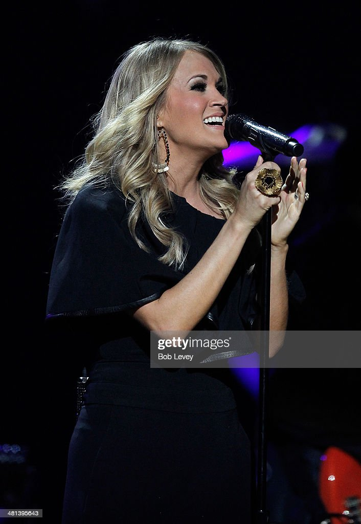 Recording artist Carrie Underwood performs onstage during iHeartRadio Country Festival in Austin at the Frank Erwin Center on March 29, 2014 in Austin, Texas.