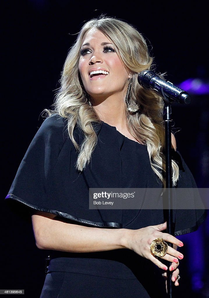 Recording artist <a gi-track='captionPersonalityLinkClicked' href=/galleries/search?phrase=Carrie+Underwood&family=editorial&specificpeople=204483 ng-click='$event.stopPropagation()'>Carrie Underwood</a> performs onstage during iHeartRadio Country Festival in Austin at the Frank Erwin Center on March 29, 2014 in Austin, Texas.