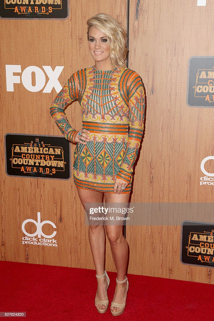 Recording artist <a gi-track='captionPersonalityLinkClicked' href=/galleries/search?phrase=Carrie+Underwood&family=editorial&specificpeople=204483 ng-click='$event.stopPropagation()'>Carrie Underwood</a> poses in the press room during the 2016 American Country Countdown Awards at The Forum on May 1, 2016 in Inglewood, California.