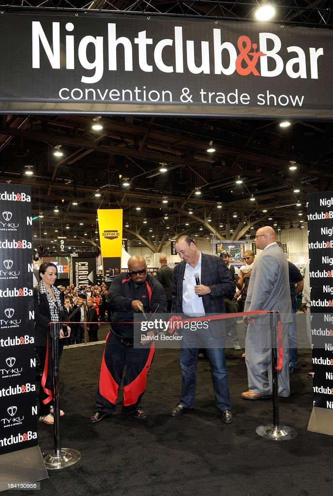 Recording artist CeeLo Green (L) and Nightclub & Bar Media Group President and host and Co-Executive Producer of the Spike television show 'Bar Rescue' Jon Taffer cut a ribbon to mark the floor opening of the 28th annual Nightclub & Bar Convention and Trade Show at the Las Vegas Convention Center on March 20th, 2013 in Las Vegas, Nevada.