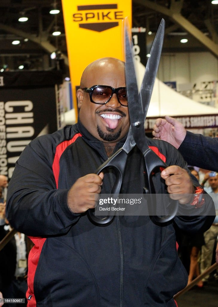 Recording artist CeeLo Green cuts a ribbon to mark the floor opening of the 28th annual Nightclub & Bar Convention and Trade Show at the Las Vegas Convention Center on March 20th, 2013 in Las Vegas, Nevada.