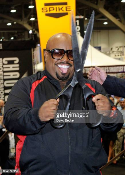 Recording artist CeeLo Green cuts a ribbon to mark the floor opening of the 28th annual Nightclub Bar Convention and Trade Show at the Las Vegas...