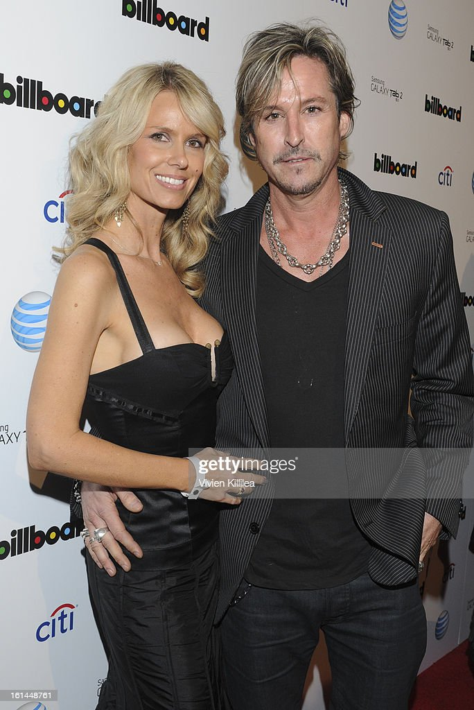 Recording artist <a gi-track='captionPersonalityLinkClicked' href=/galleries/search?phrase=Charlie+Colin&family=editorial&specificpeople=2997546 ng-click='$event.stopPropagation()'>Charlie Colin</a> of Train (R) and his wife (L) attend Citi And AT&T Present The Billboard After Party at The London Hotel on February 10, 2013 in West Hollywood, California.