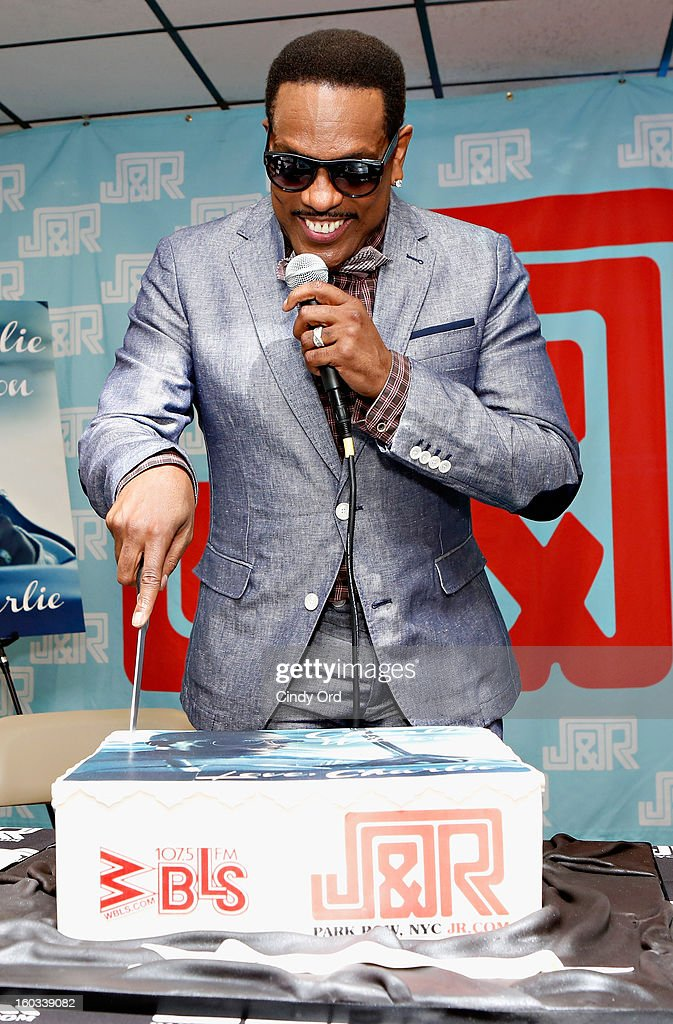 Recording artist Charlie Wilson cuts a birthday cake presented to him at J&R Music World on January 29, 2013 in New York City.