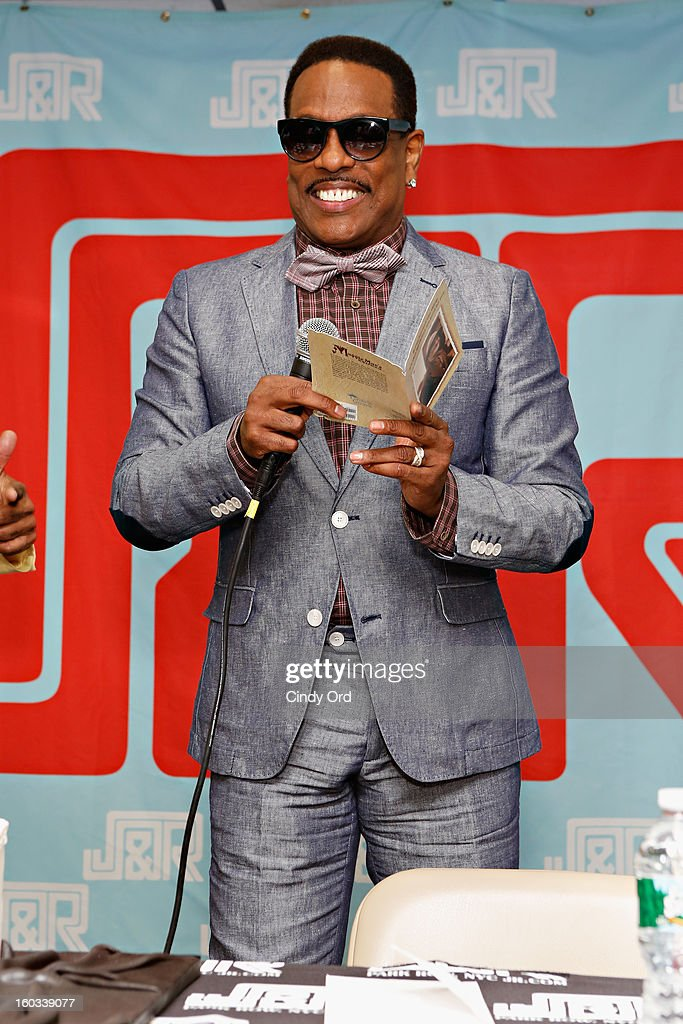 Recording artist Charlie Wilson receives a birthday card from a fan during his visit to J&R Music World on January 29, 2013 in New York City.