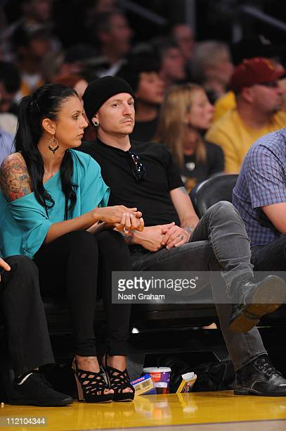Recording Artist Chester Bennington of Linkin Park and his wife Talinda attend a game between the San Antonio Spurs and the Los Angeles Lakers at...