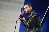 Recording artist Chris Brown accepts the award for 'Best RB Artist of the Year' onstage at the iHeartRadio Music Awards which broadcasted live on TBS...