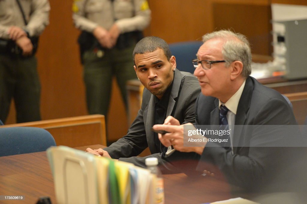 Recording artist Chris Brown and attorney <a gi-track='captionPersonalityLinkClicked' href=/galleries/search?phrase=Mark+Geragos&family=editorial&specificpeople=201725 ng-click='$event.stopPropagation()'>Mark Geragos</a> during Brown's court appearance on July 15, 2013 in Los Angeles, California. Brown appeared in court for a probation review hearing related to the 2009 domestic violence case in which he pleaded guilty to assaulting his then-girlfriend singer Rihanna.