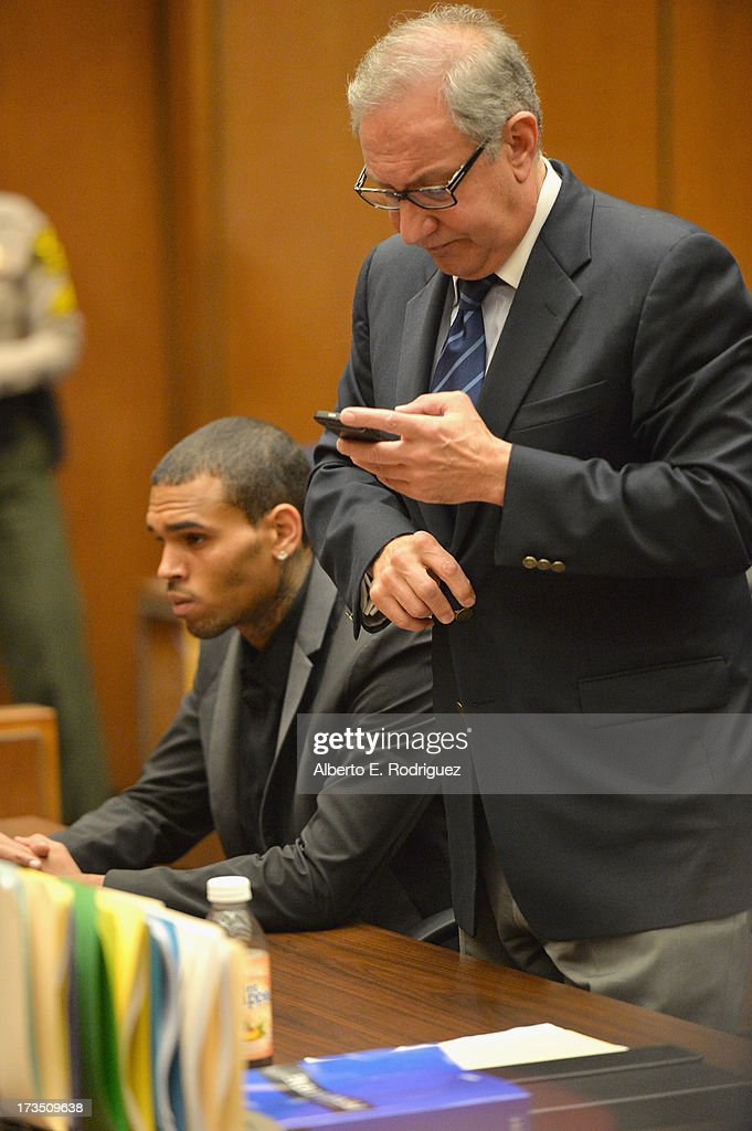 Recording artist Chris Brown and attorney Mark Geragos during Brown's court appearance on July 15 2013 in Los Angeles California Brown appeared in...
