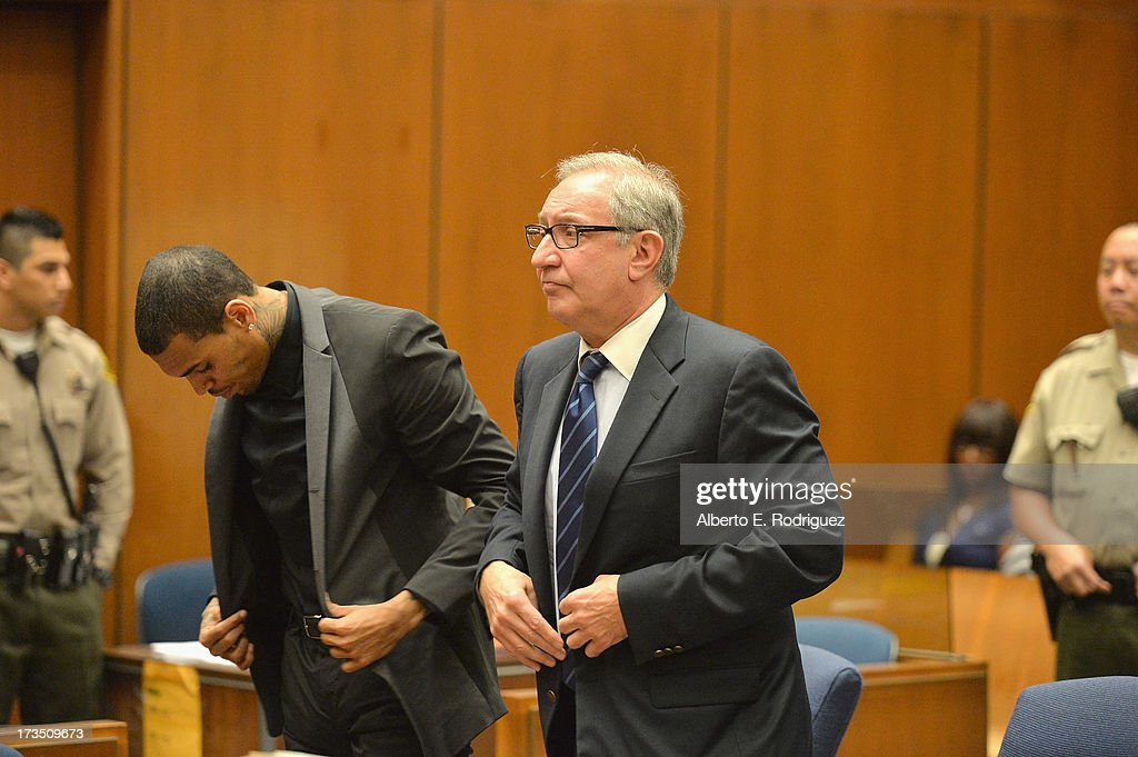 Recording artist Chris Brown and attorney Mark Geragow during Brown's court appearance on July 15, 2013 in Los Angeles, California. Brown appeared in court for a probation review hearing related to the 2009 domestic violence case in which he pleaded guilty to assaulting his then-girlfriend singer Rihanna on July 15, 2013 in Los Angeles, California.