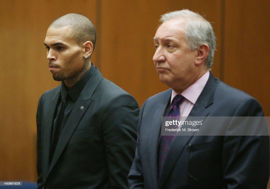 Recording artist Chris Brown (L) and his attorney <a gi-track='captionPersonalityLinkClicked' href=/galleries/search?phrase=Mark+Geragos&family=editorial&specificpeople=201725 ng-click='$event.stopPropagation()'>Mark Geragos</a> appear in Los Angeles court on November 20, 2013 in Los Angeles, California. Brown was ordered to 90 days at an inpatient center, random drug testing and 24 hours of weekly community service. Brown was arrested last month for misdemeanor assault in Washington, DC and was already on probation for a felony domestic violence charge after a 2009 incident with then-girlfriend Rihanna.