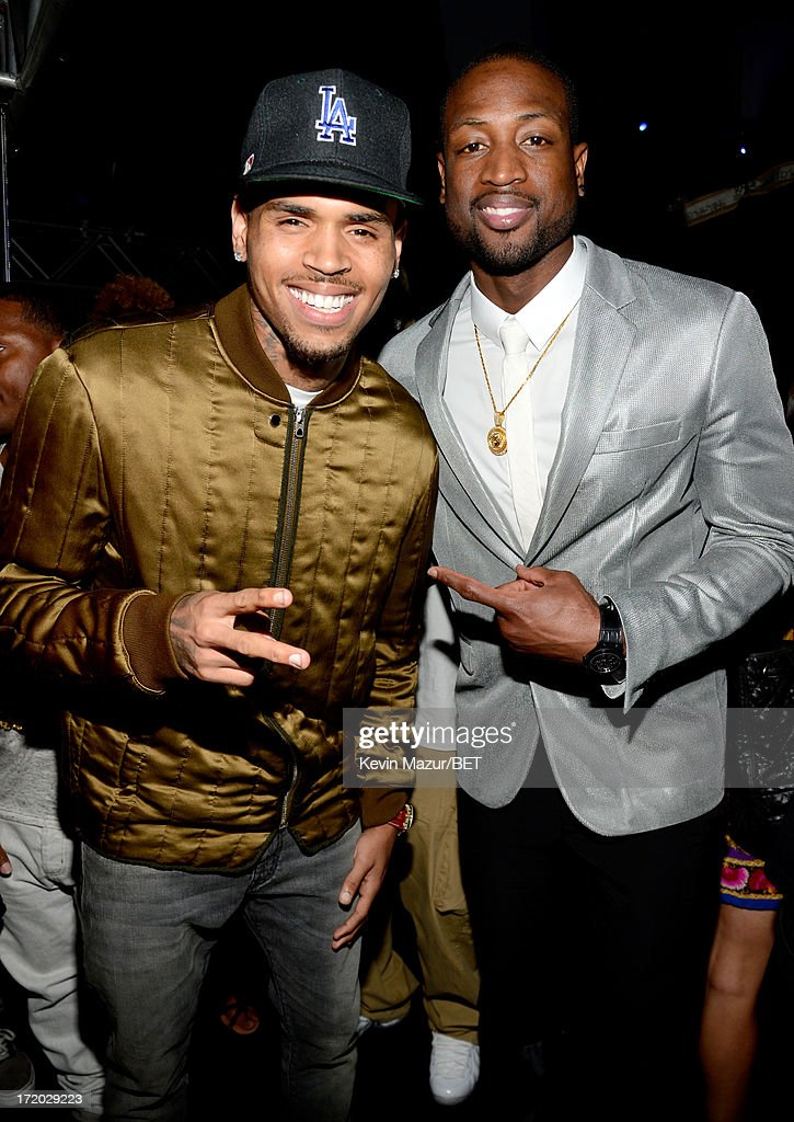 Recording artist Chris Brown (L) and NBA player <a gi-track='captionPersonalityLinkClicked' href=/galleries/search?phrase=Dwyane+Wade&family=editorial&specificpeople=201481 ng-click='$event.stopPropagation()'>Dwyane Wade</a> pose backstage during the 2013 BET Awards at Nokia Theatre L.A. Live on June 30, 2013 in Los Angeles, California.