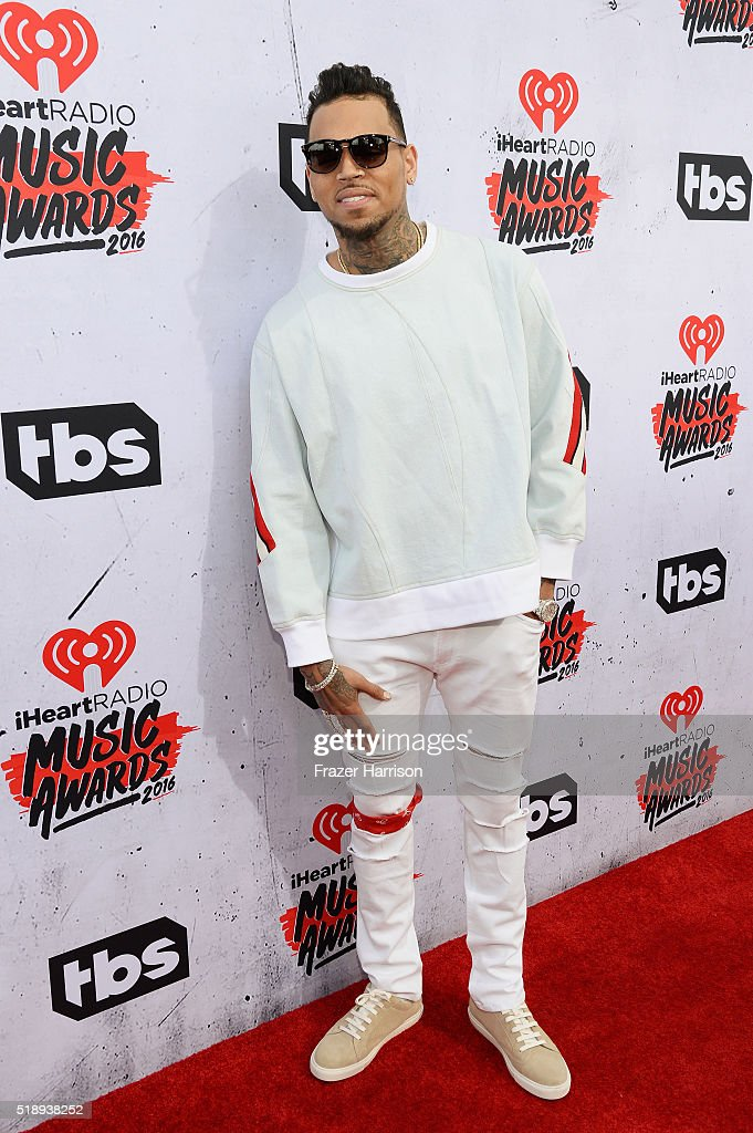 recording-artist-chris-brown-attends-the-iheartradio-music-awards-at-picture-id518938252