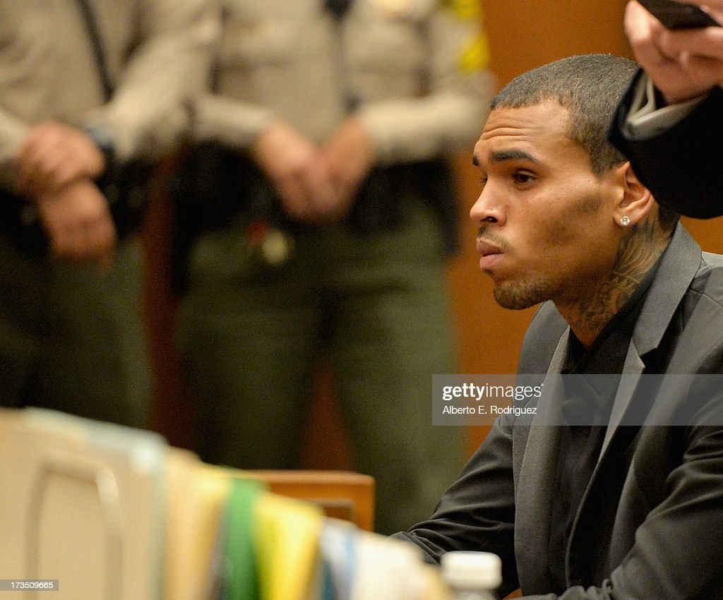 Recording artist Chris Brown during his court appearance on July 15, 2013 in Los Angeles, California. Brown appeared in court for a probation review hearing related to the 2009 domestic violence case in which he pleaded guilty to assaulting his then-girlfriend singer Rihanna.