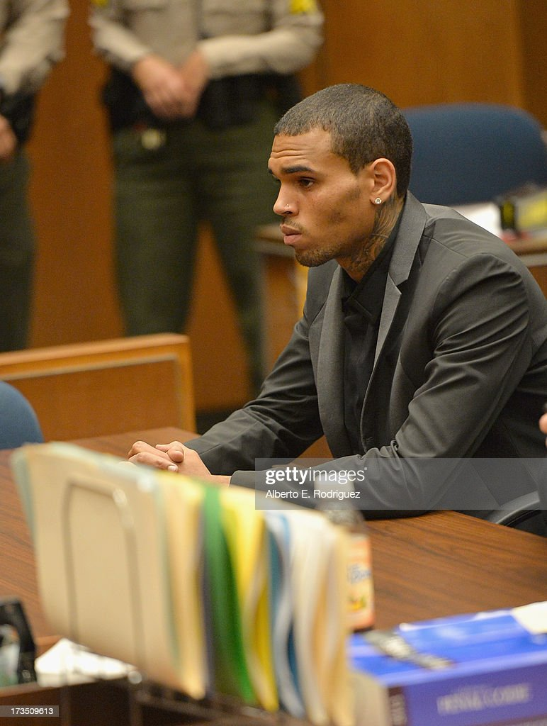 Recording artist <a gi-track='captionPersonalityLinkClicked' href=/galleries/search?phrase=Chris+Brown+-+Singer&family=editorial&specificpeople=4452016 ng-click='$event.stopPropagation()'>Chris Brown</a> during is court appearance on July 15, 2013 in Los Angeles, California. Brown appeared in court for a probation review hearing related to the 2009 domestic violence case in which he pleaded guilty to assaulting his then-girlfriend singer Rihanna.