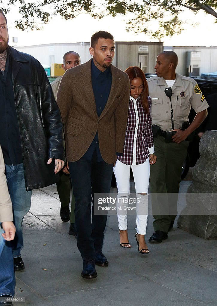 Recording artist <a gi-track='captionPersonalityLinkClicked' href=/galleries/search?phrase=Chris+Brown+-+Singer&family=editorial&specificpeople=4452016 ng-click='$event.stopPropagation()'>Chris Brown</a> enters the Los Angeles Courthouse on February 3, 2014 in Los Angeles, California. Brown has been on probation since pleading guilty to assaulting his then girlfriend, singer Rihanna, after a pre-Grammy Awards party in 2009. He has been in anger management treatment program and performing community service requirements but failure to meet probation requirements could be even further complicated by assault charges he and bodyguard Christopher Hollosy face stemming from an incident outside the W hotel in Washington D.C. last October.