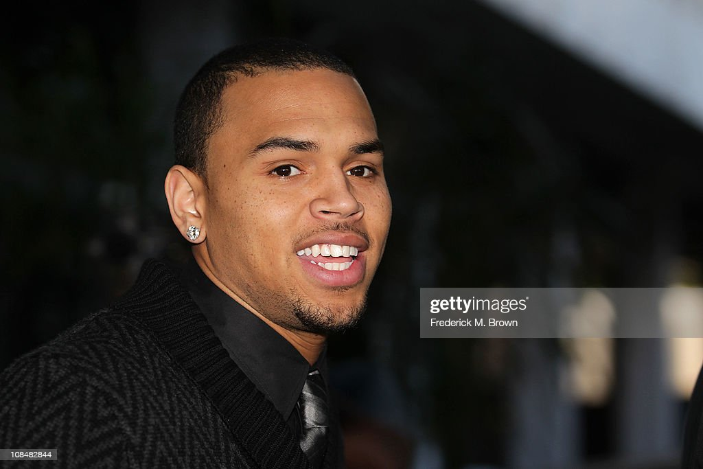Recording artist Chris Brown leaves the Los Angeles courthouse after a probation progress hearing on January 28 2011 in Los Angeles California Brown...