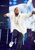 Recording artist Chris Brown performs onstage during 'The UR Experience' tour at Staples Center on November 21 2014 in Los Angeles California