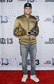 Recording Artist Chris Brown poses with the Fandemonium Award in the Backstage Winner's Room at Nokia Theatre LA Live on June 30 2013 in Los Angeles...