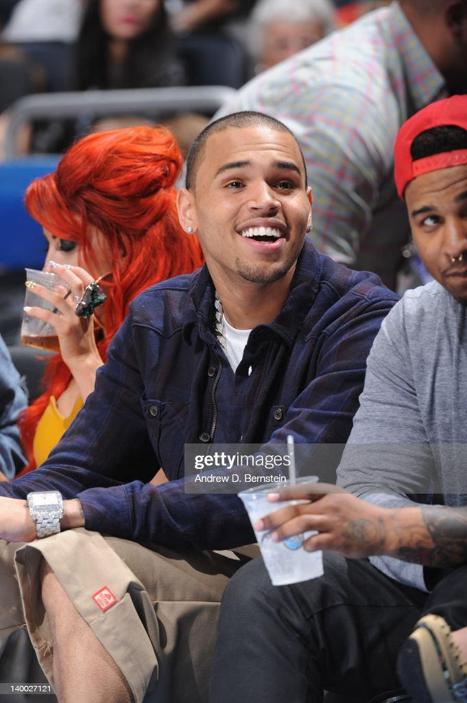 Recording artist Chris Brown sits courtside during the 2012 NBA All-Star Game presented by Kia Motors as part of 2012 All-Star Weekend at the Amway Center on February 26, 2012 in Orlando, Florida.