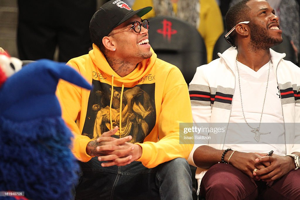 Recording artist Chris Brown watches the game courtside during 2013 NBA All-Star Game on February 17, 2013 at Toyota Center in Houston, Texas.