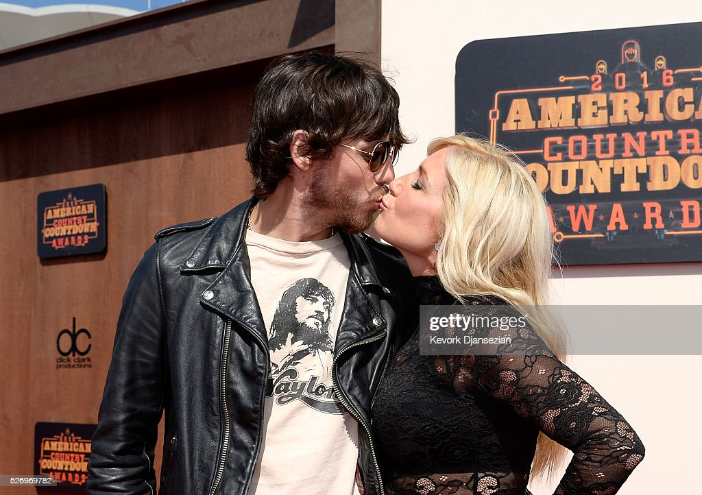 Recording artist Chris Janson and wife Kelly Lynn Janson attends the 2016 American Country Countdown Awards at The Forum on May 1, 2016 in Inglewood, California.