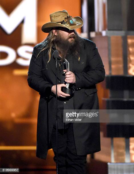 Recording artist Chris Stapleton accepts the Album of the Year award for 'Traveller' onstage during the 51st Academy of Country Music Awards at MGM...