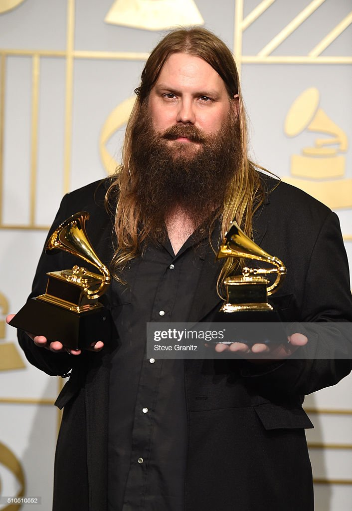 Recording artist Chris Stapleton, winner of the Best Country Solo Performance and Best Country Album awards for his album 'Traveller,' poses in the press room during The 58th GRAMMY Awards at Staples Center on February 15, 2016 in Los Angeles, California.