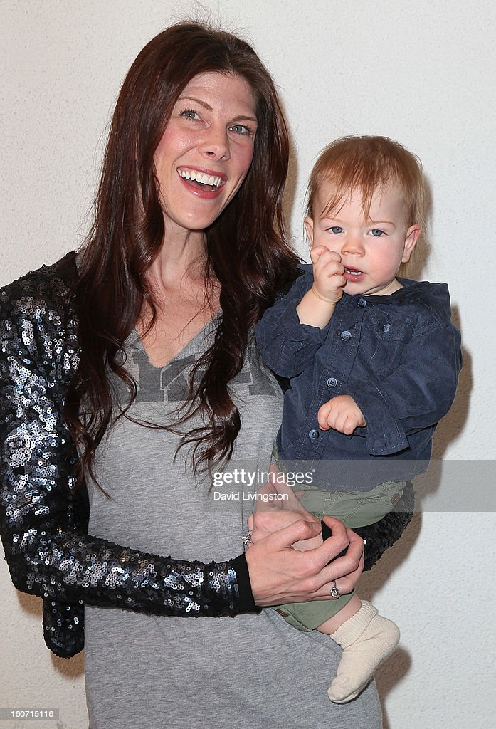 Recording artist Christa Black (L) and son Moses Grae Lionheart attend the Anti-Human Trafficking Family Charity Luncheon in support of Unlikely Heroes at the Veggie Grill on February 4, 2013 in Los Angeles, California.