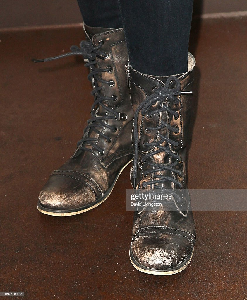 Recording artist Christa Black (shoe detail) attends the Anti-Human Trafficking Family Charity Luncheon in support of Unlikely Heroes at the Veggie Grill on February 4, 2013 in Los Angeles, California.