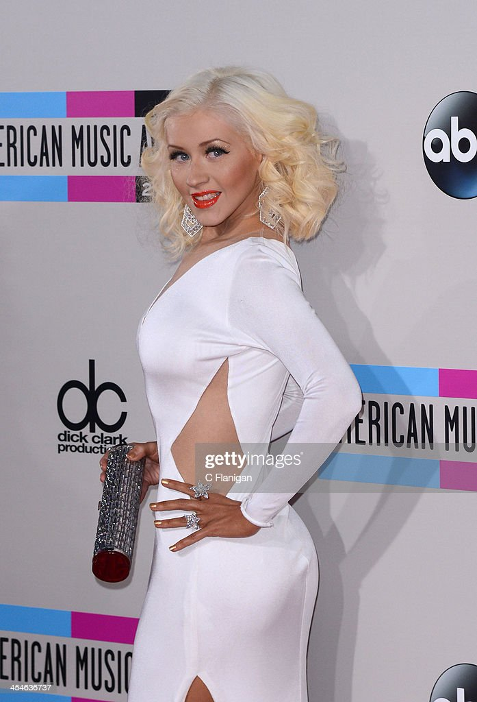 Recording artist <a gi-track='captionPersonalityLinkClicked' href=/galleries/search?phrase=Christina+Aguilera&family=editorial&specificpeople=171272 ng-click='$event.stopPropagation()'>Christina Aguilera</a> arrives at the 2013 American Music Awards at Nokia Theatre L.A. Live on November 24, 2013 in Los Angeles, California.