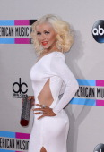 Recording artist Christina Aguilera arrives at the 2013 American Music Awards at Nokia Theatre LA Live on November 24 2013 in Los Angeles California