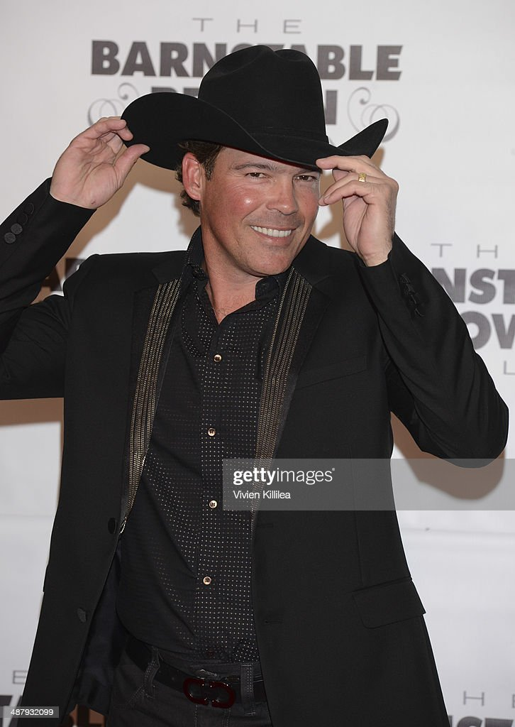 Recording artist <a gi-track='captionPersonalityLinkClicked' href=/galleries/search?phrase=Clay+Walker&family=editorial&specificpeople=614635 ng-click='$event.stopPropagation()'>Clay Walker</a> attends the Barnstable Brown Kentucky Derby Eve Gala at Barnstable Brown House on May 2, 2014 in Louisville, Kentucky.