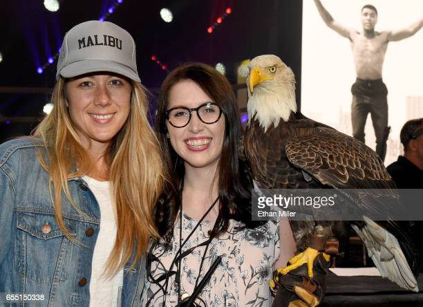 Recording artist Colbie Caillat and American Eagle Foundation's Julia Cecere pose with a bald eagle named Challenger during rehearsals for Muhammad...