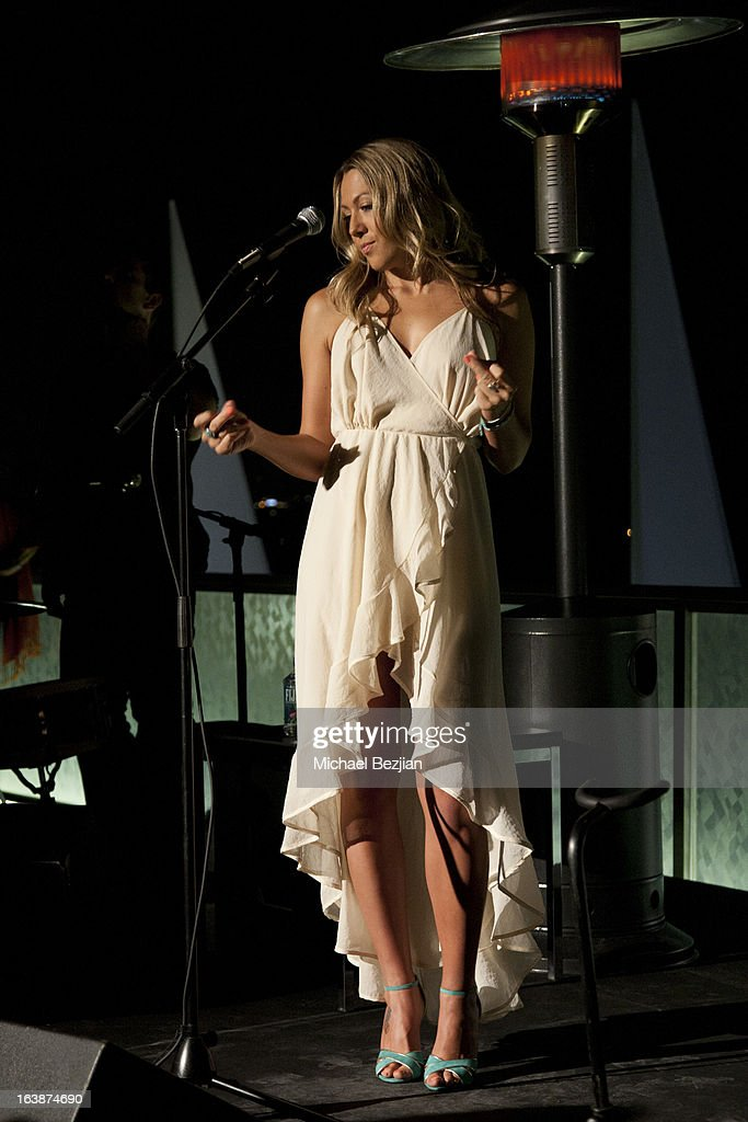 Recording Artist Colbie Caillat performs at 'Fun For Animals' Celebrity Poker Tournament and Cocktail Party at Petersen Automotive Museum on March 16, 2013 in Los Angeles, California.
