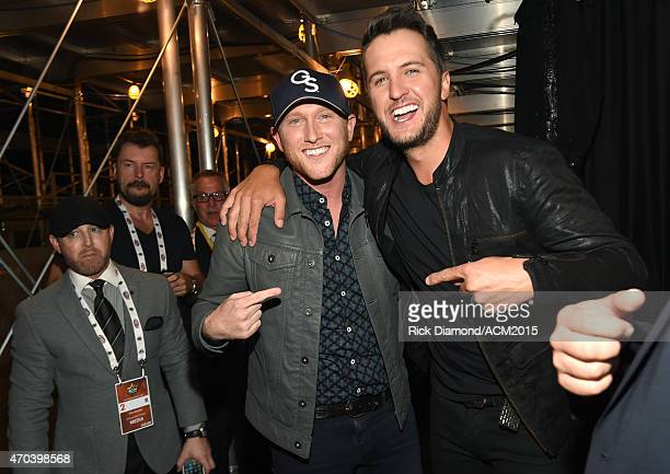 Recording artist Cole Swindell and host Luke Bryan attend the 50th Academy of Country Music Awards at ATT Stadium on April 19 2015 in Arlington Texas