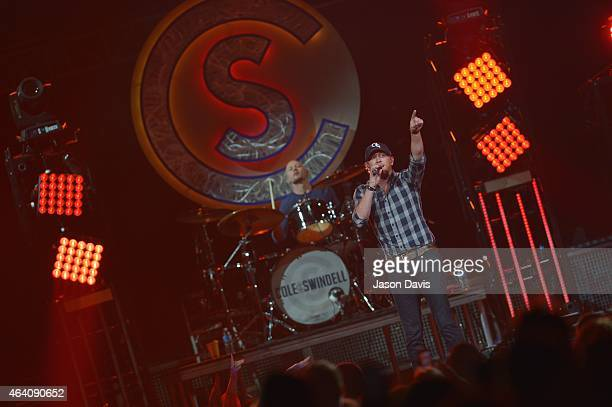 Recording artist Cole Swindell performs during Jason Aldean's Burn It Down Tour at Bridgestone Arena on February 21 2015 in Nashville Tennessee