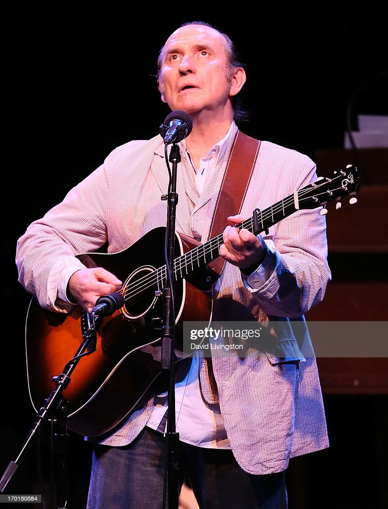 Recording artist <a gi-track='captionPersonalityLinkClicked' href=/galleries/search?phrase=Colin+Hay&family=editorial&specificpeople=1953993 ng-click='$event.stopPropagation()'>Colin Hay</a> performs during A Prairie Home Companion taping at the Greek Theatre on June 7, 2013 in Los Angeles, California.