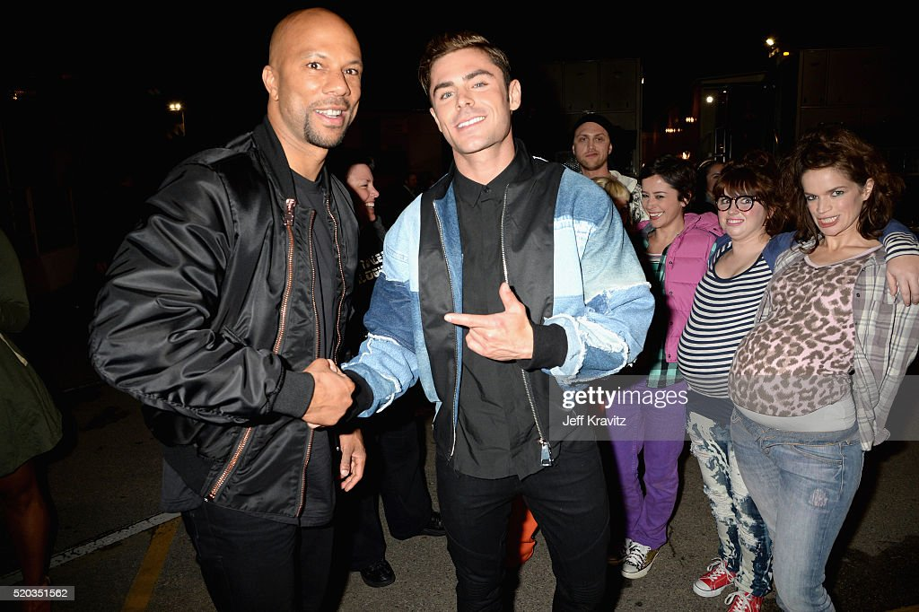 Recording artist Common (L), actor Zac Efron (C) and pregnant performers attend the 2016 MTV Movie Awards at Warner Bros. Studios on April 9, 2016 in Burbank, California. MTV Movie Awards airs April 10, 2016 at 8pm ET/PT.