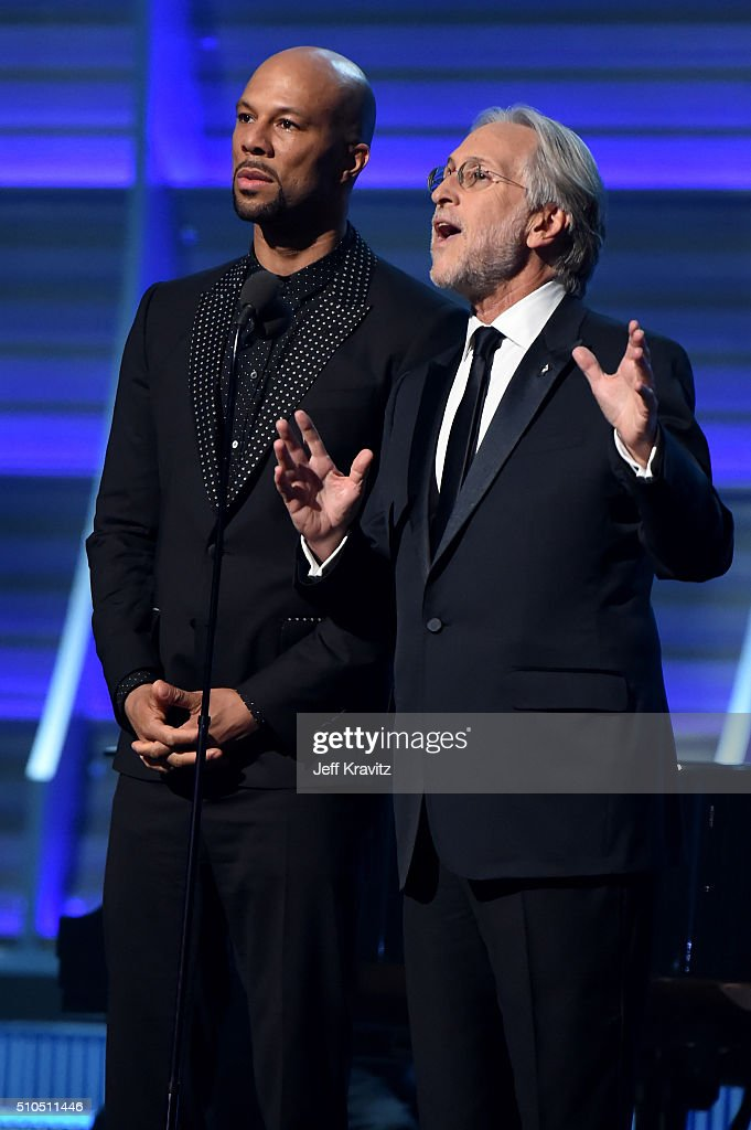 Recording Artist Common and President of the National Academy of Recording Arts and Sciences Neil Portnow speak onstage during The 58th GRAMMY Awards...