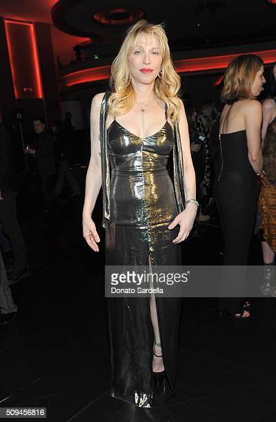 Recording artist Courtney Love in Saint Laurent by Hedi Slimane attends Saint Laurent at the Palladium on February 10 2016 in Los Angeles California...